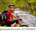 Bikes cycling girl with big rucksack cycling 22760965