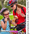 Bikes cycling girls with rucksack cycling eating 22760967