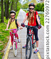 Girls children cycling on yellow bike lane. 22760972