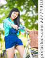 Asian young woman with bike in a summer park 22774910