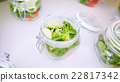 vegetable salad in glass jar on white background 22817342