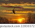 Hang glider fly in the sunset 22830372