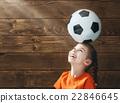Child plays football. 22846645