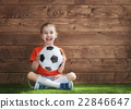 Girl plays football. 22846647