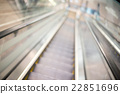 Escalator blur background with bokeh 22851696