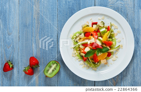 Stock Photo: Fruit salad closeup, vegan food.