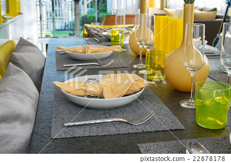 served with a plate in yellow colors decoration 22878178