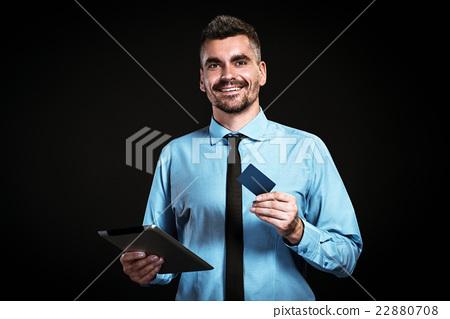 Handsome businessman on black background 22880708