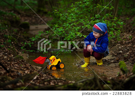 funny boy playing with excavator 22883828