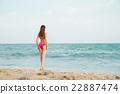 Hot girl wearing pink bikini on the summer beach 22887474