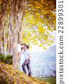 asia happy couple standing under tree 22899301