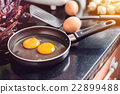 Eggs in a frying pan 22899488