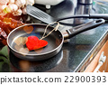 Eggs in a frying pan for Love 22900393