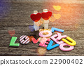 Love message written on wood background 22900402