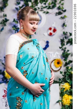 Pregnant woman in indian sari 22901696
