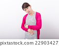 A woman who holds her stomach 22903427