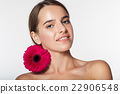 Pretty girl with perfect skin and red flower 22906548