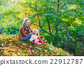 mother and her little daughter at beautiful autumn 22912787