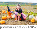 little girl wearing halloween witch costume on 22912857