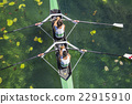 Two rowers  rowing 22915910