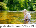 Cute little toddler girl having fun by a river 22925193