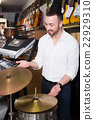 Male buyer selecting drums and accessories 22929310