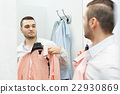 Man trying on new shirt 22930869