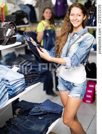 woman selecting jeans 22931036
