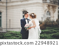 wedding couple is standing and kissing in the 22948921