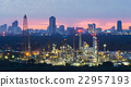 Petrochemical refinery with city downtown  22957193