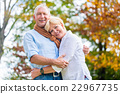 Senior man and woman embracing each other in love 22967735