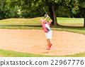 Senior woman at golf having stroke in sand bunker 22967776