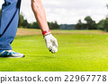 Man putting golf ball on tee, close shot 22967778