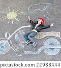 Little child in helmet with motorcycle picture 22988444
