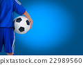 Back view of youth soccer player in blue uniform 22989560