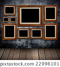 Grungy wall with gold frames and wood background. 22996101