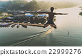 Young boy jumping into river 22999276