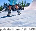 Girl riding on roller skates . 23003490