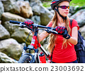 Bikes cycling girl into park. 23003692