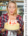 Woman blowing out candles 23018220