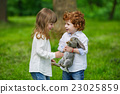 boy and girl playing with rabbit 23025859
