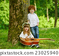 cute children playing guitar 23025940