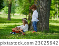 cute children playing guitar 23025942