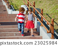 boy and girl walking on stairway 23025984