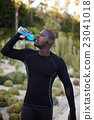 Attractive fit man in active clothes refreshing 23041018