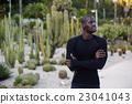 Black man with crossed hands looking away 23041043