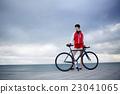 Female with rental bike enjoying weekend stroll 23041065