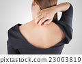 woman scratching her itchy back with allergy rash 23063819
