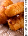 Detail of crispy potato croquettes with salt 23064469