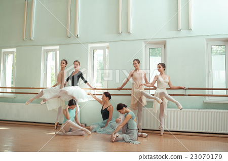 The seven ballerinas at ballet bar 23070179